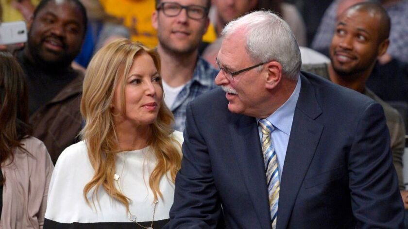 Lakers president Jeanie Buss and former Lakers Coach Phil Jackson during a game against the Maverick
