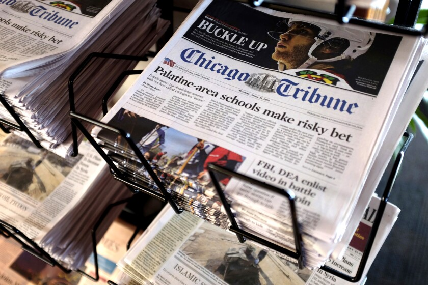 A stack of Chicago Tribune newspapers on a metal rack