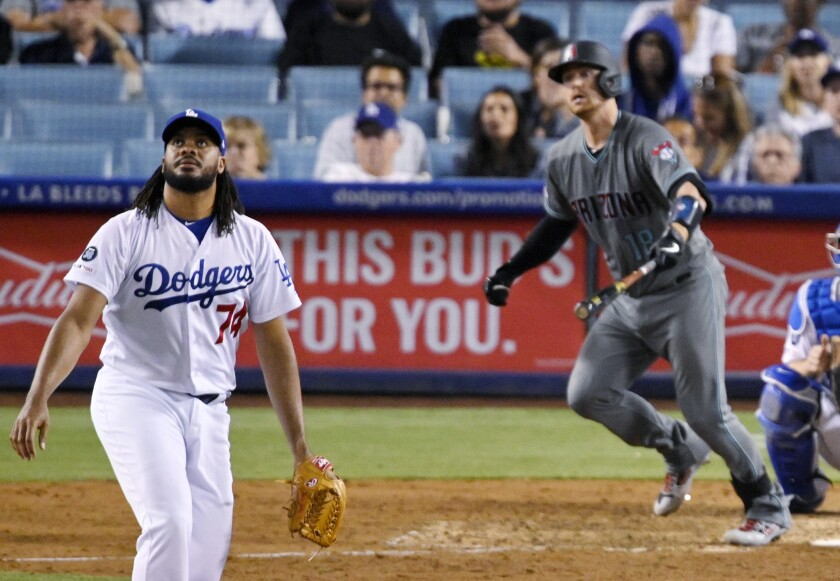 Dodgers closer Kenley Jansen watches Carson Kelly's game-tying two-run homer Friday night.