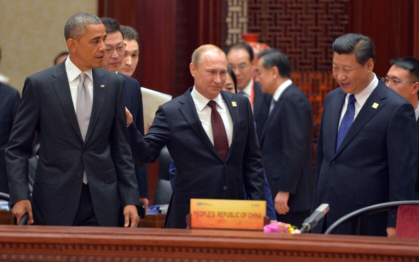 President Obama, Russian President Vladimir Putin and Chinese President Xi Jinping arrive at the Asia-Pacific Economic Cooperation summit's plenary session in Beijing on Tuesday.