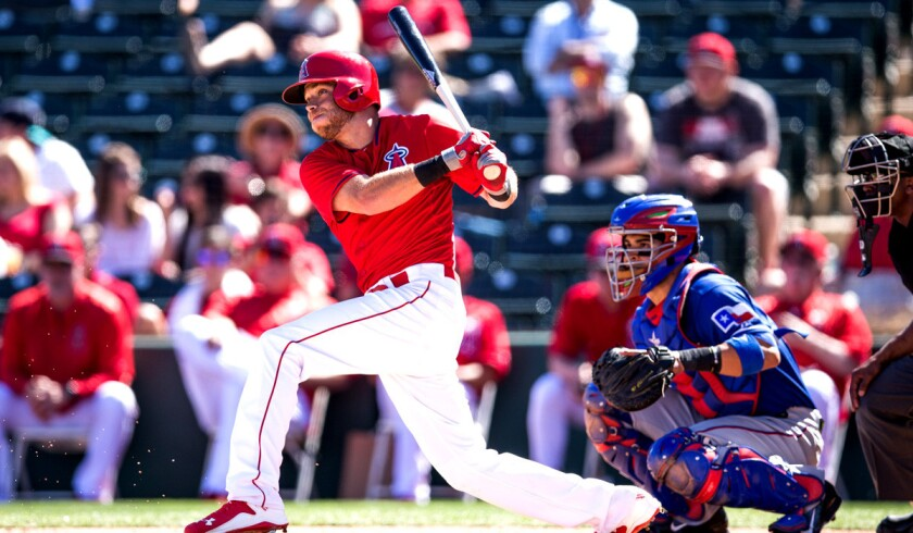 Angels infielder Taylor Featherston bats during a spring training game against the Texas Rangers on Tuesday.