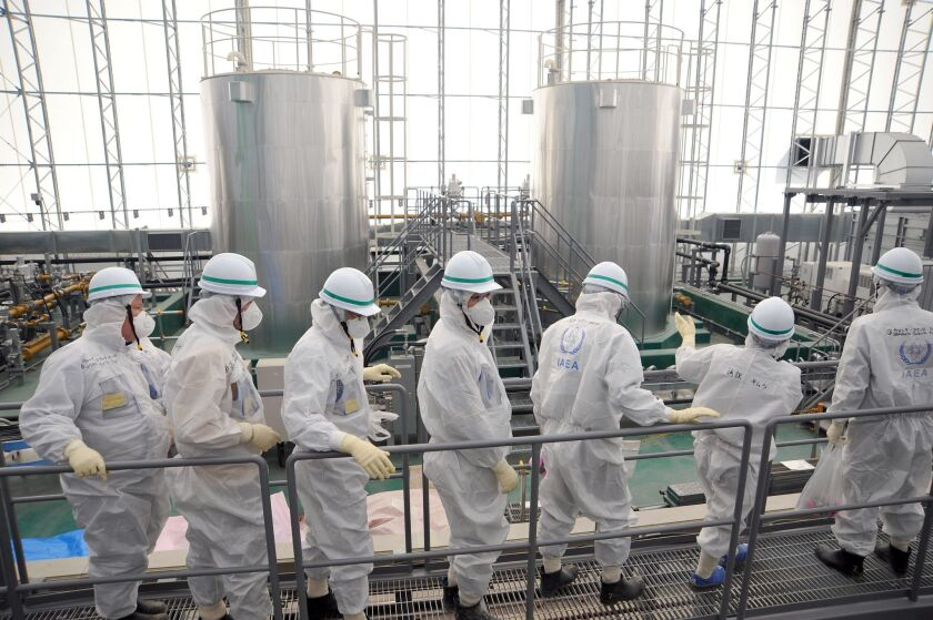 An International Atomic Energy Agency team inspects the Fukushima Dai-ichi nuclear power plant Feb. 17 in an official photo.