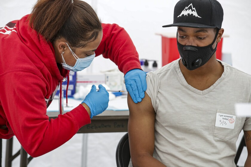 A man receives a vaccine.