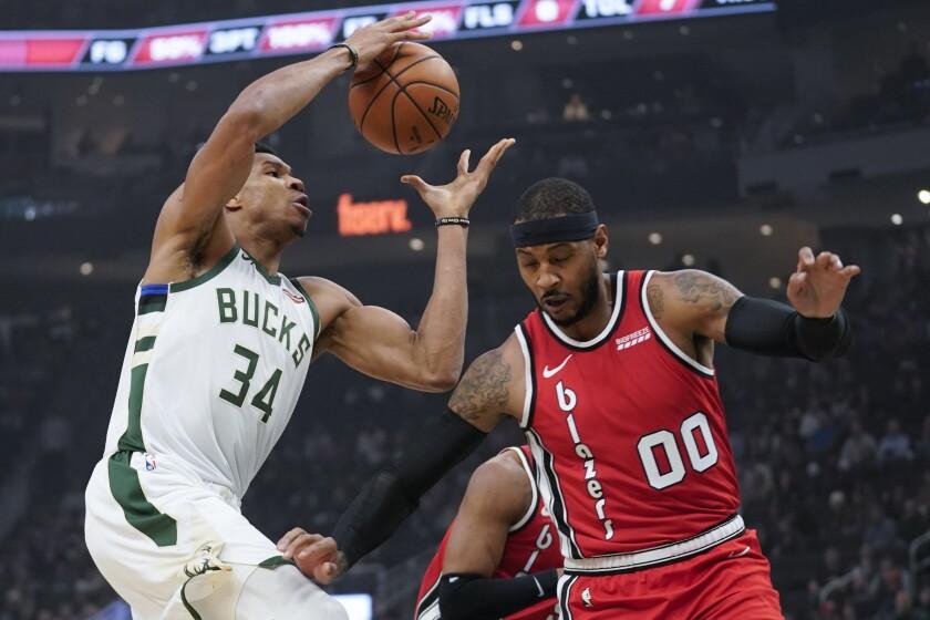 Milwaukee Bucks' Giannis Antetokounmpo shoots over Portland Trail Blazers' Carmelo Anthony during the first half of an NBA basketball game Thursday, Nov. 21, 2019, in Milwaukee. (AP Photo/Morry Gash)
