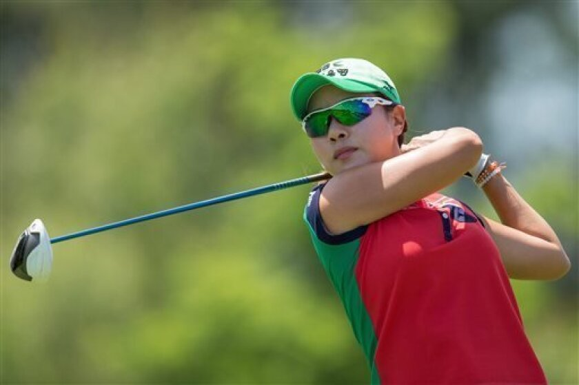 Hee Young Park, of South Korea, hits off the fourth tee during the third round of the Manulife Financial LPGA Classic golf tournament in Waterloo, Ontario, Saturday, July 13, 2013. (AP Photo/The Canadian Press, Geoff Robins)