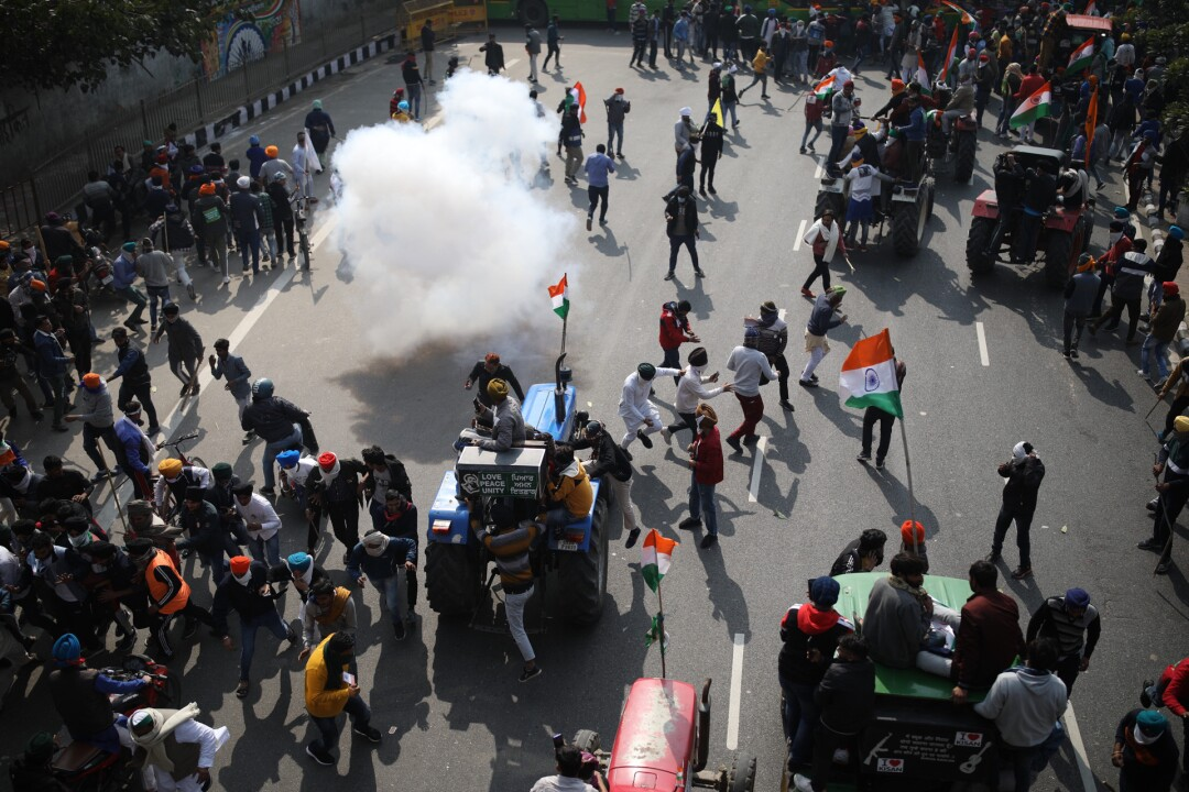 Police use tear gas to disperse farmers who marched to New Delhi during India's Republic Day celebrations on Tuesday.