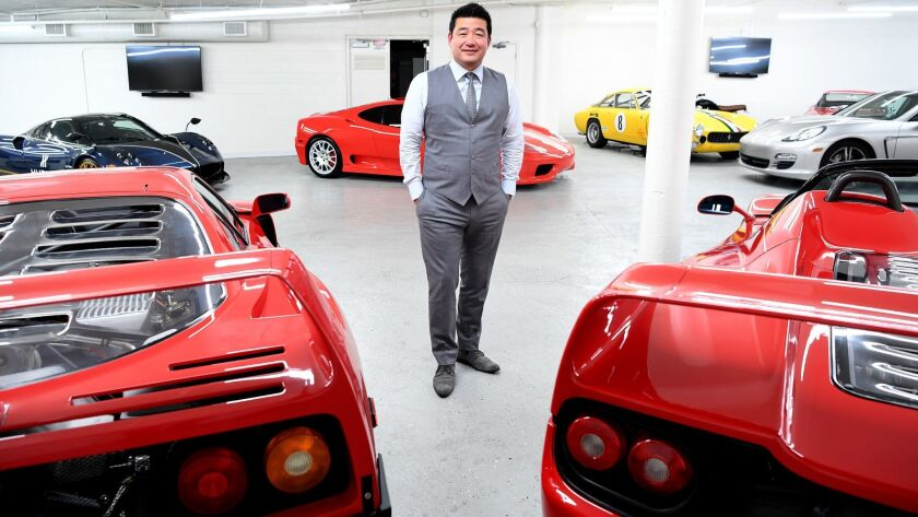 WALNUT, CALIFORNIA MARCH 2, 2017-Timepiece and jewelry entrepreneur David Lee poses with his Ferrari