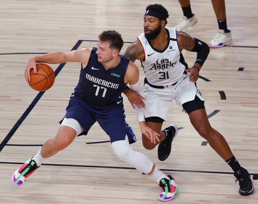 Dallas' Luka Doncic is defended by Clippers forward Marcus Morris Sr. during their playoff series.
