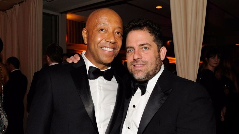 Russell Simmons, left, and Brett Ratner attend the 2013 Vanity Fair Oscar Party in West Hollywood.