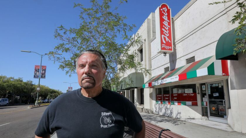 Bob DePhilippis, owner of Filippi's Pizza Grotto, stands in front of his business on Grand Avenue in downtown Escondido.