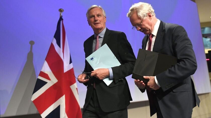 British Secretary of State for Exiting the European Union (Brexit Minister) David Davis (R) and Euro
