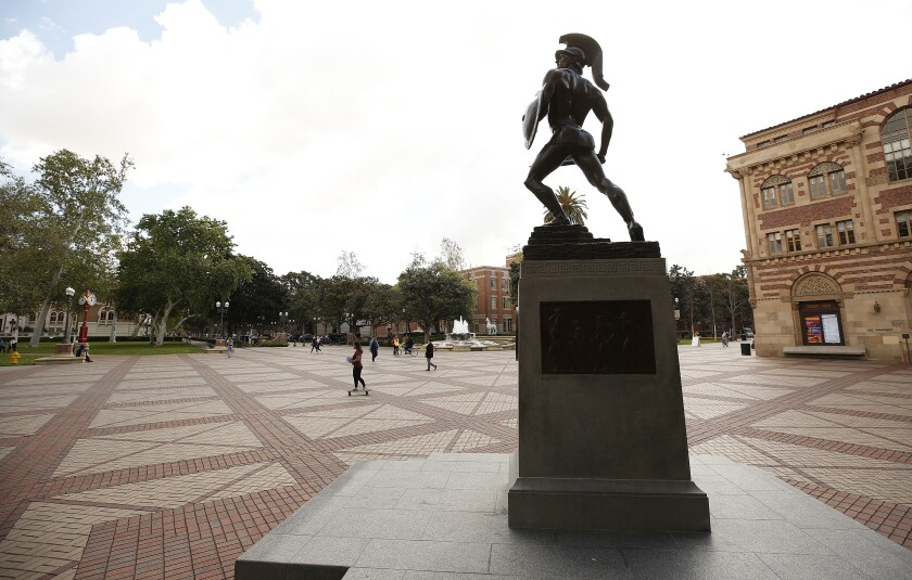A statue of Tommy Trojan stands over the USC campus.