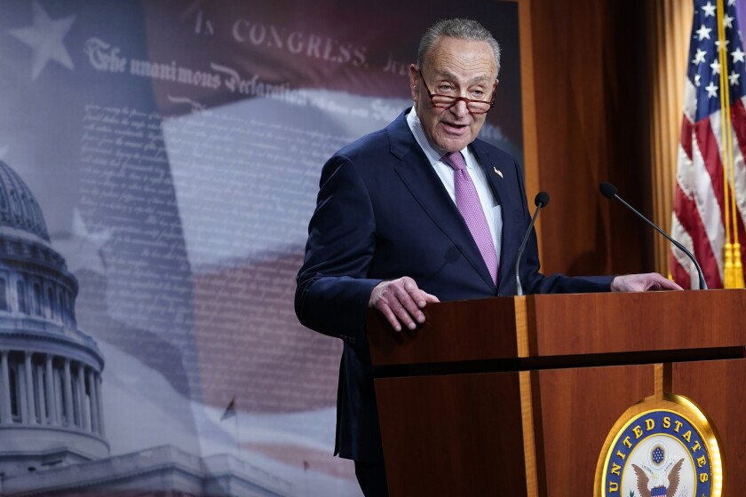 Sen. Charles Schumer speaks at a lectern bearing the United States Senate seal