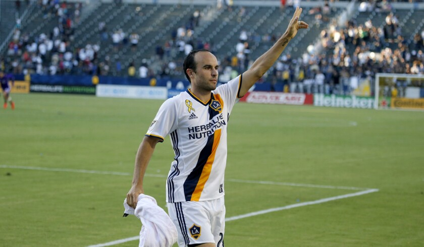 Landon Donovan thanks cheering L.A. Galaxy fans during his first game back from retirement as the Galaxy beat the Orlando City SC, 4-2, at the Stub Hub Center on Sept. 11.