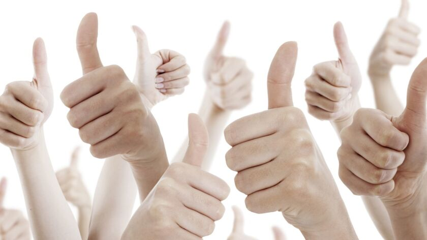 Many people holding their thumbs up on white background