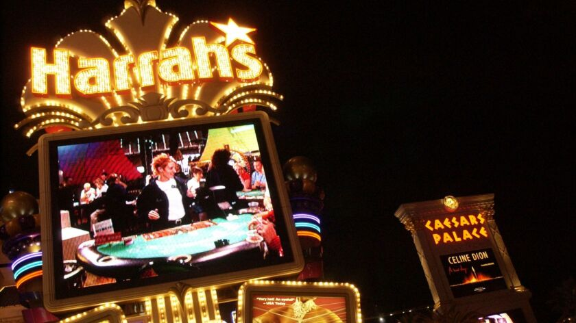 Harrah's casino and and Caesars Palace are shown in Las Vegas on Wednesday night, June 14, 2004. Har
