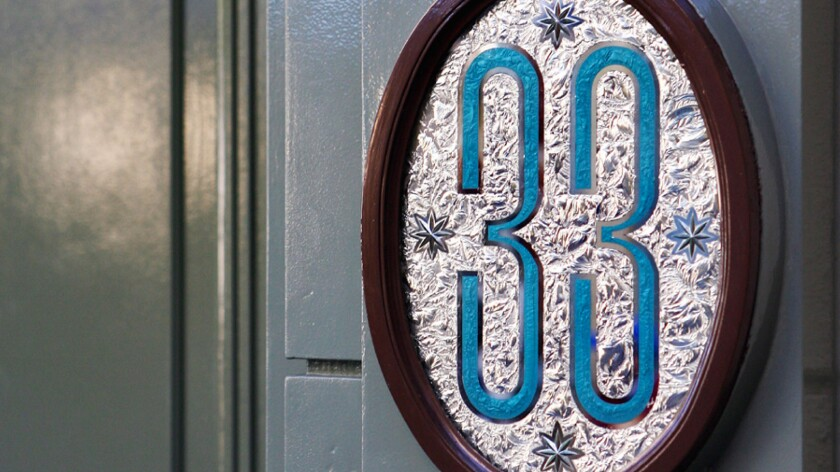 """The hidden club takes its name from its 33 Royal Street address in Disneyland's New Orleans Square, marked by only a """"33"""" sign next to a locked green door."""