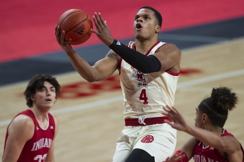 Nebraska's Shamiel Stevenson makes a layup in the first half of an NCAA college basketball game on Sunday, Jan. 10, 2021. (Kenneth Ferriera/Lincoln Journal Star via AP)