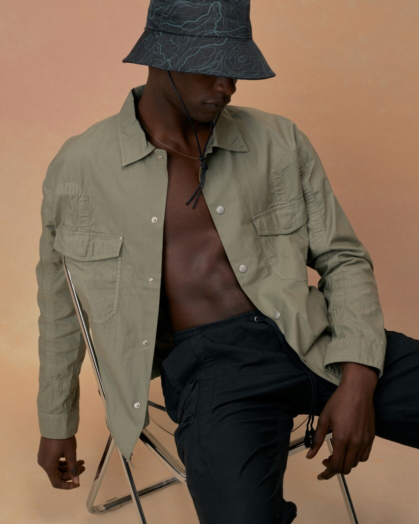 A model wearing clothes designed by John Elliott.