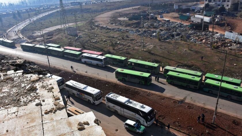 Civilians from the remaining rebel-held pockets of eastern Aleppo are evacuated by bus on Dec. 19, 2016.