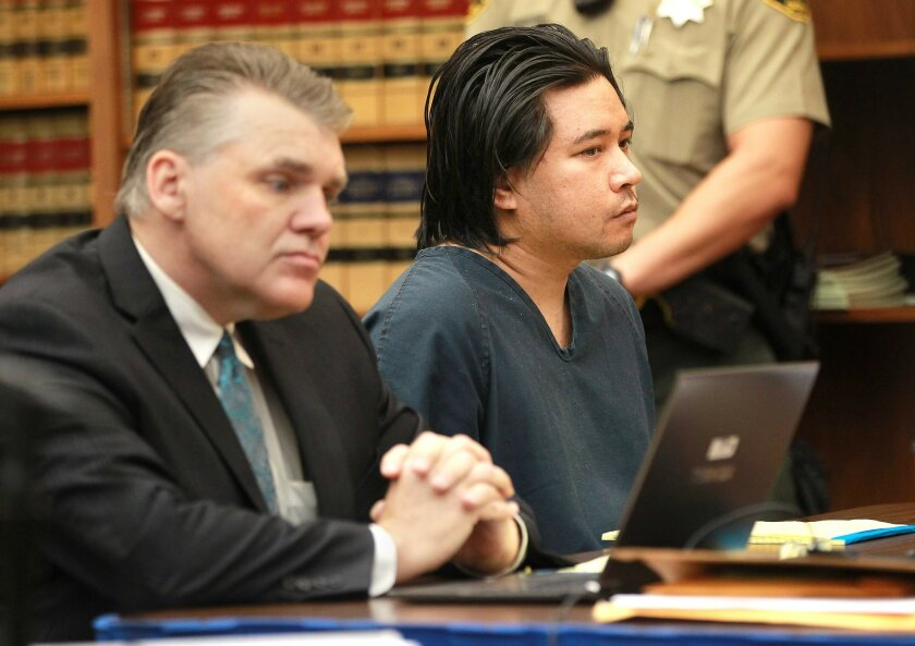 Defendant Carlo Gallopa Mercado, right, sitting with his attorney, Gary Gibson from the public defender's office, was in court for a preliminary hearing in the deaths of Ilona Flint and Salvatore Belvedere, both 22, and his older brother Gianni Belvedere, 24.