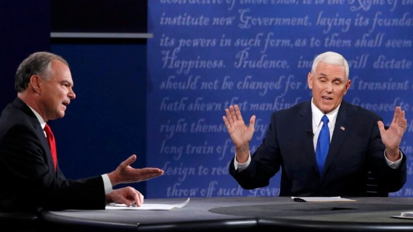Democratic U.S. vice presidential nominee Senator Tim Kaine (L) and Republican U.S. vice presidential nominee Governor Mike Pence discuss an issue during their vice presidential debate at Longwood University in Farmville, Virginia, U.S., October 4, 2016.