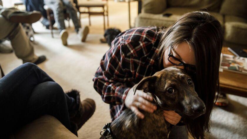 APPLEGATE, CALIF. -- WEDNESDAY, NOVEMBER 14, 2018: Alexandria Wilson, 21, kisses her dog Harley, aft