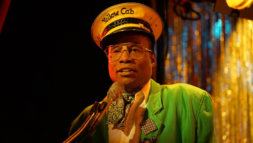 """Billy Porter wears a yellow taxi driver cap and a bright green jacket as Pray Tell in """"Pose."""""""