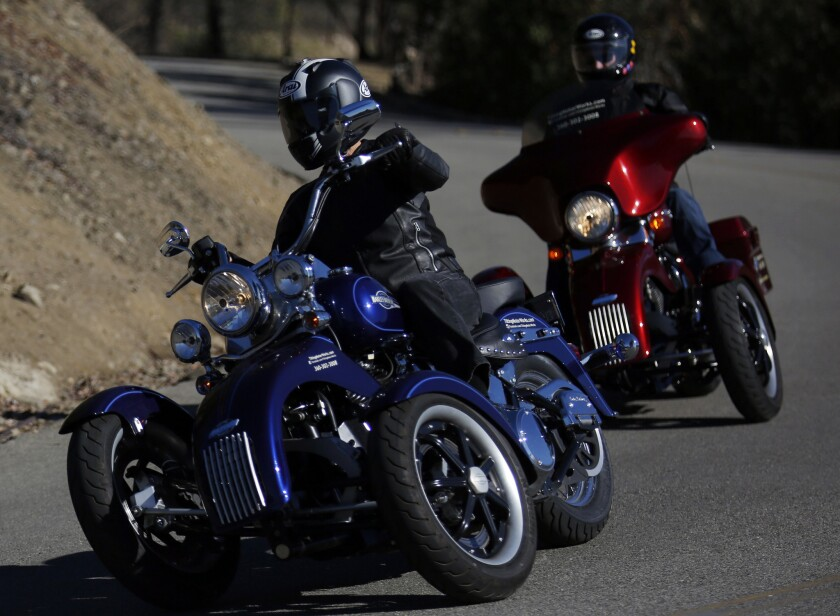"""A kit from Tilting Motor Works can turn any Harley-Davidson cruiser into a """"reverse trike"""" — two wheels in the front, one in back — that leans like a bike but won't fall over."""