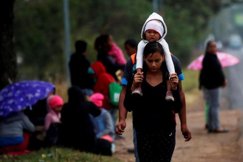 A caravan of United States-bound Honduran migrants make their way on foot from the Honduran-Guatemalan border to Guatemala City on Jan. 16, 2019. EPA-EFE/ESTEBAN BIBA