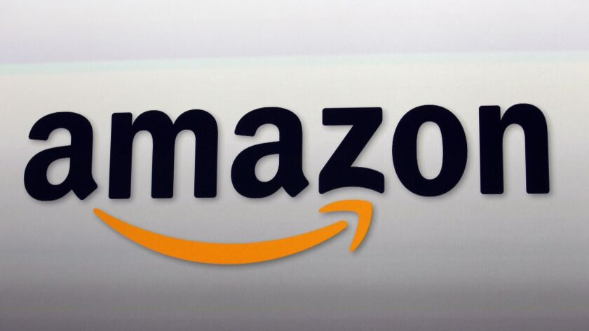 FILE - This Sept. 6, 2012, file photo, shows the Amazon logo in Santa Monica, Calif. Amazon's clou