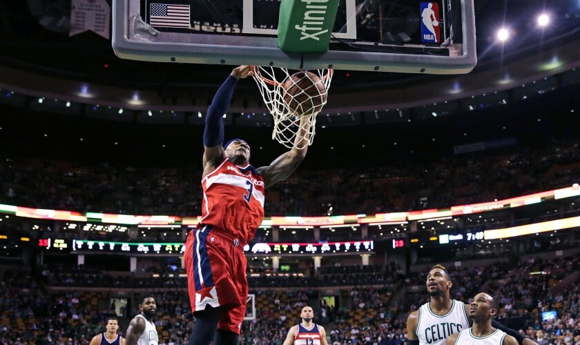 Washington Wizards guard Bradley Beal (3) slams a dunk against the Boston Celtics during the first quarter of an NBA basketball game in Boston, Friday, Nov. 6, 2015. (AP Photo/Charles Krupa)