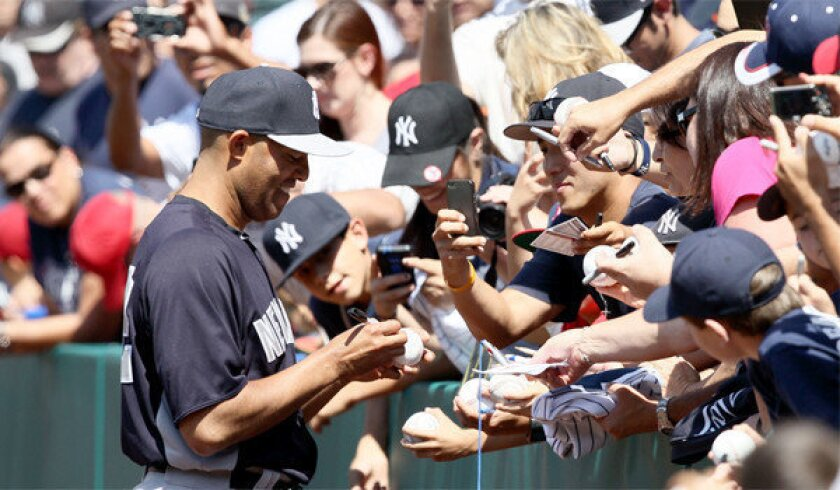 New York Yankees closer Mariano Rivera signed autographs for fans at Angel Stadium before Saturday's game.