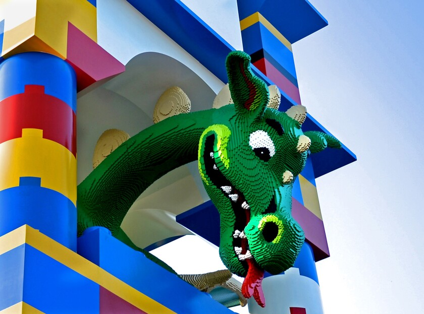 A dragon looms in the tower at entrance to the Legoland California Hotel in Carlsbad. The hotel offers sale prices on rooms on Black Friday.