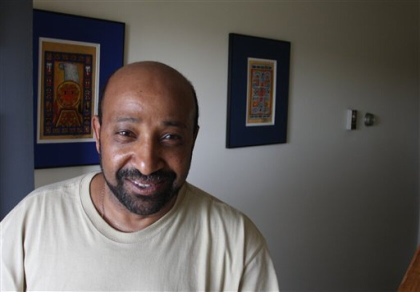 FILE - In this April 25, 2009 file photo, Dr. Berhanu Nega poses for a photo in his house in Lewisburg, Pa. An Ethiopian court sentenced five people to death Tuesday Dec. 22, 2009 including Nega, an Ethiopian professor teaching at a U.S. university, and 33 to life in prison for being members of a terror group and conspiring to assassinate government officials. Nega, an exiled opposition leader who was elected mayor of Addis Ababa in 2005, is currently an associate professor of economics at Bucknell University in Pennsylvania. (AP Photo/John Zeedick, File)