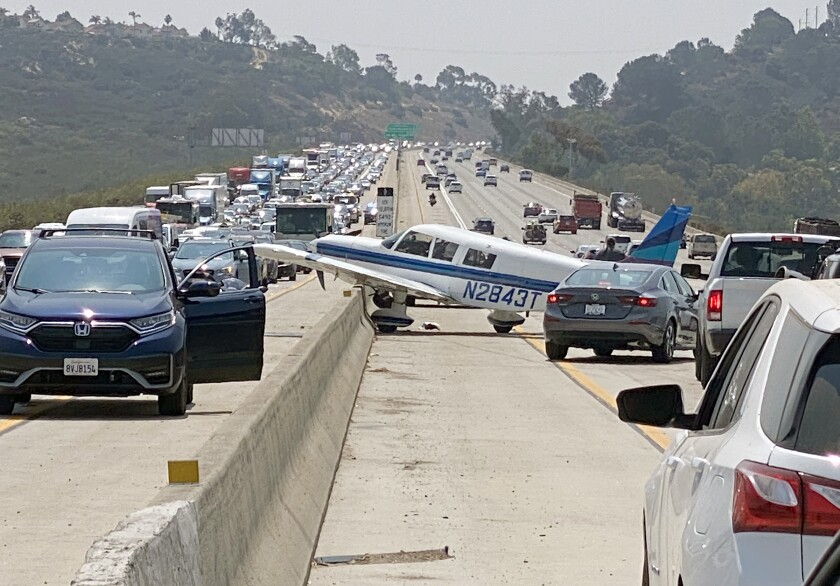 A small single engine plane made an emergency landing on the southbound I-5 freeway near Del Mar