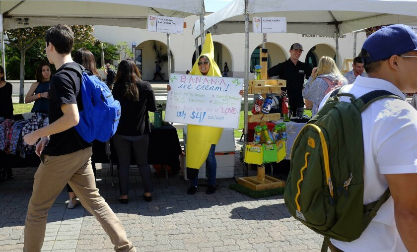 Dozens of students participated in Entrepreneur Day at San Diego State University on Thursday. Gilanne Del Rosario, who helps out with The Banana Ice Cream Co., found an eye-catching way to promote the company started by Justine Smith.