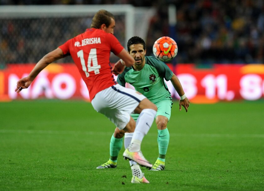 Portugal's Joao Moutinho, right, eyes Norway's Veton Berisha during a friendly soccer match between Portugal and Norway at the Dragao stadium in Porto, Portugal, Sunday, May 29, 2016. The Portuguese squad is in preparation for the UEFA EURO 2016 soccer championships, hosted by France. (AP Photo/Pau