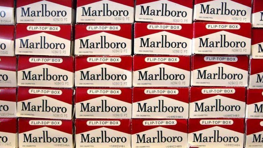 Cartons of Marlboro brand cigarettes are seen inside a Cigarettes Cheaper store