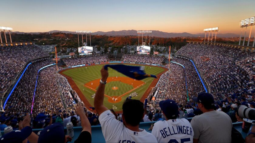 Fans cheer on the Dodgers during game two of the World Series at Dodger Stadium in Los Angeles on Oct. 25.