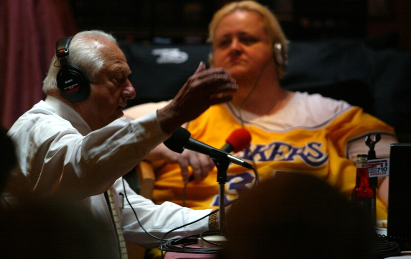 Joe McDonnell interviews former Dodgers manager Tommy Lasorda during a live show at Phil Trani's restaurant in Long Beach on Dec. 1, 2003.