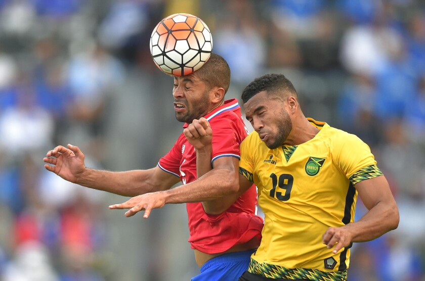 Costa Rica's Alvaro Saborio, left, and Jamaica's Adrian Mariappa try to head the ball during the second half of a CONCACAF Gold Cup soccer match at the StubHub Center.