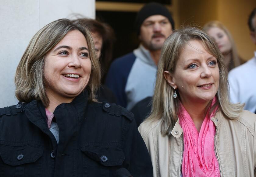 Cari Searcy, left, and Kim McKeand, plaintiffs in the case that struck down Alabama's same-sex marriage ban, hold a news conference Jan. 26 in Mobile.