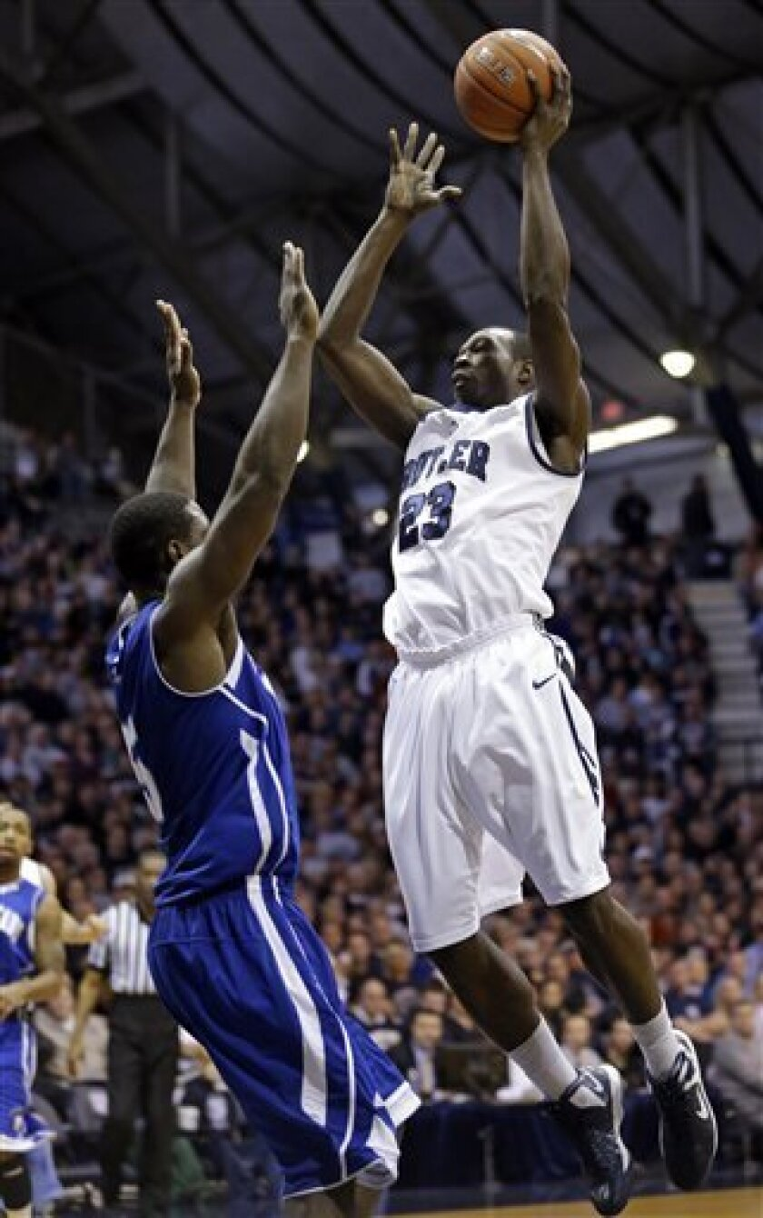 Butler forward Khyle Marshall, right, shoots over New Orleans forward Eddie Denard during the first half of an NCAA college basketball game, Saturday, Jan. 5, 2013, in Indianapolis. (AP Photo/Michael Conroy)