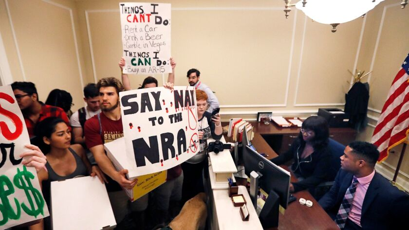 High school students demonstrate at the entrance to Florida Gov. Rick Scott's office and deliver boxes of petitions for more gun control on Feb. 21.