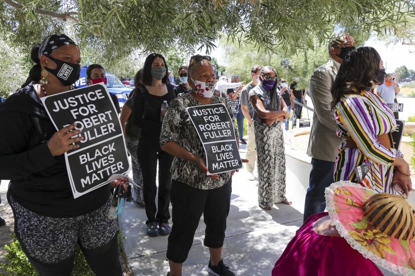 Demonstrators hold Black Lives Matter signs in Lancaster