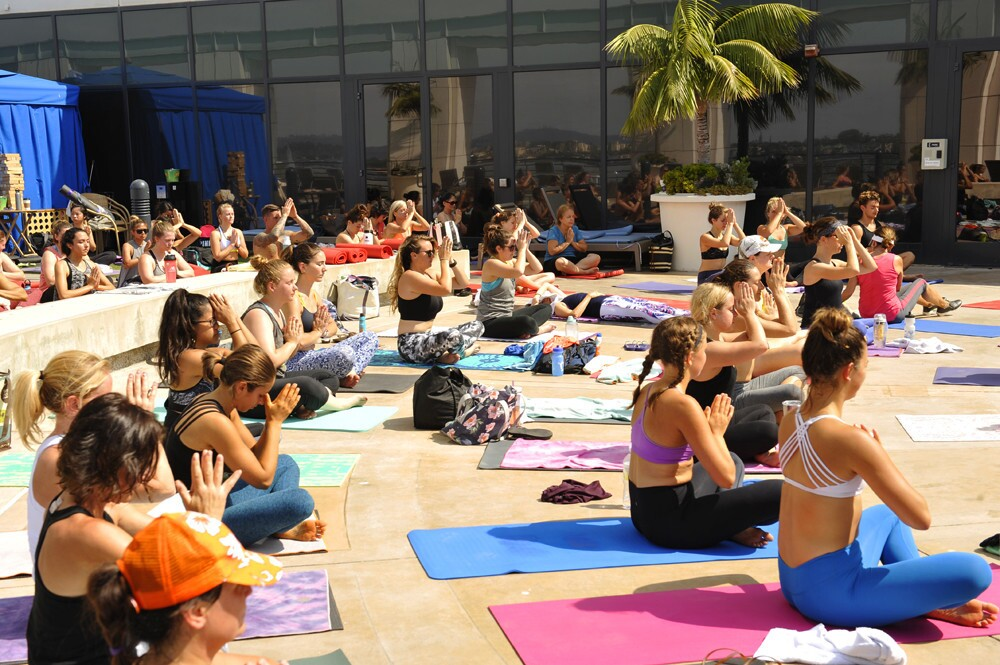 It was all downward facing dog and cool vibes during Yoga by the Pool at the Grand Hyatt San Diego on Saturday, July 29, 2017. (Jared Gase)