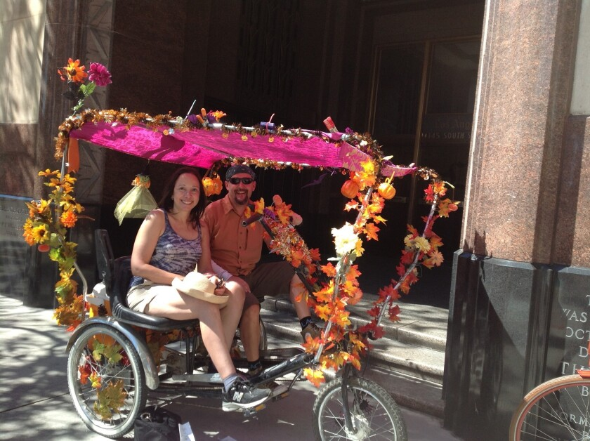 Colin Bogart, the education director of the Los Angeles County Bicycle Coalition, takes Carla Hall for a ride on a handmade pedicycle at CicLAvia.