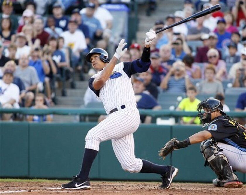 New York Yankees' Alex Rodriguez hits a solo home run in the third inning of a Class AA baseball game with the Trenton Thunder against the Reading Phillies, Friday, Aug. 2, 2013, in Trenton, N.J. (AP Photo/Tom Mihalek)