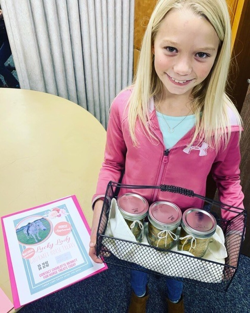Charlie Merritt, 9, proudly displays some of her homemade horse treats.